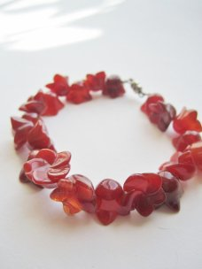 https://www.etsy.com/ca/listing/75248870/carnelian-carved-flower-bracelet-red?