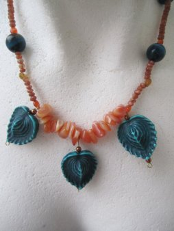 https://www.etsy.com/ca/listing/468418558/orange-and-teal-necklace-teal-leaves?