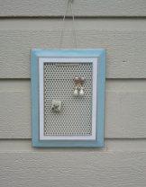 https://www.etsy.com/listing/474533812/earring-holder-blue-and-white-metal?