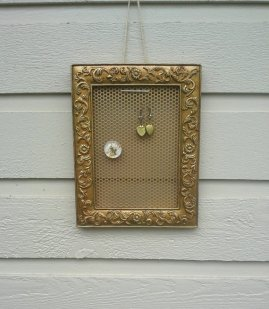 https://www.etsy.com/listing/488264403/earring-holder-vintage-resin-frame-in-an?