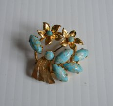 https://www.etsy.com/ca/listing/465291775/vintage-faux-turquoise-and-gold-flowers?