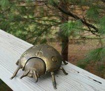https://www.etsy.com/ca/listing/476222072/brass-ladybug-hinged-ashtray?