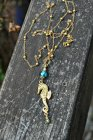 https://www.etsy.com/ca/listing/463348286/golden-seahorse-necklace-with-blue-glass?
