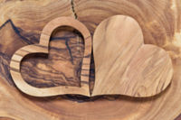 two wooden hearts on a wooden background