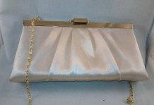 https://www.etsy.com/ca/listing/279332722/vintage-genuine-sax-clutch-handbag-purse?