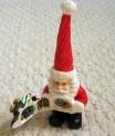 https://www.etsy.com/ca/listing/247546472/hinged-santa-small-christmas-figurine?