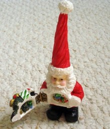 https://www.etsy.com/ca/listing/247546472/hinged-santa-small-christmas-figurine?