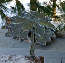 https://www.etsy.com/ca/listing/263689848/1984-teleflora-poinsettia-trivet-cast?